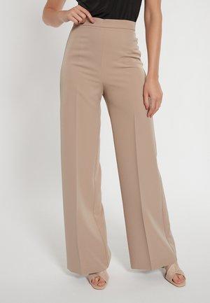 DASKANI - Trousers - beige