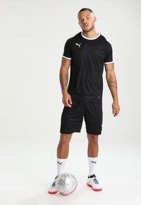 Puma - LIGA - kurze Sporthose - black/white - 1