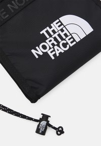 The North Face - BOZER NECK POUCH UNISEX - Axelremsväska - black - 3