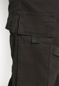 Urban Classics - TACTICAL TROUSER - Cargo trousers - black - 3