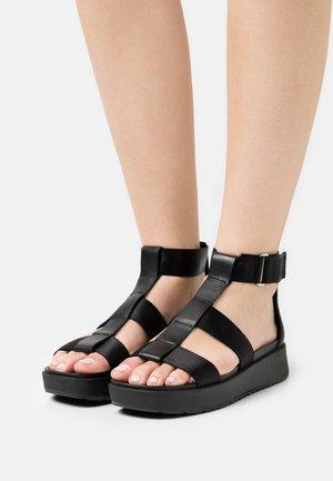 EEBA - Sandalen met plateauzool - black