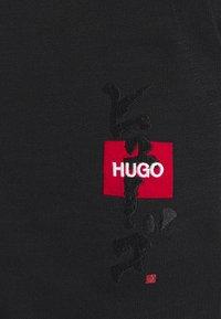 HUGO - DOHAGI - Tracksuit bottoms - black - 5