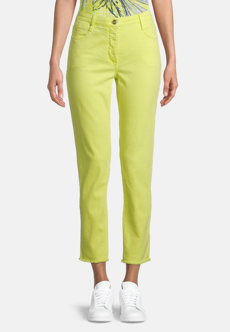 Betty Barclay - MIT OFFENEM SAUM - Slim fit jeans - neon yellow