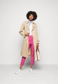 Polo Ralph Lauren - MODERN STRETCH - Trousers - pink glory - 1