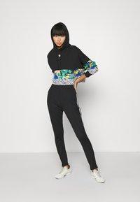 adidas Originals - 70S PANT - Leggings - Trousers - white/black - 1