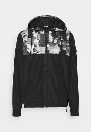 CARGO - Training jacket - black
