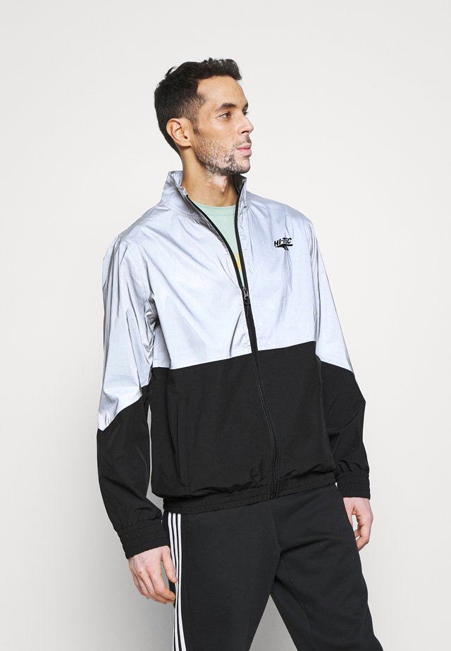MELVIN COLOURBLOCK REFLECTIVE TRACK JACKET - Training jacket - black