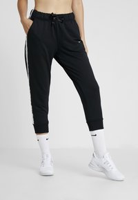 Nike Performance - DRY GET FIT - Tracksuit bottoms - black/white - 0