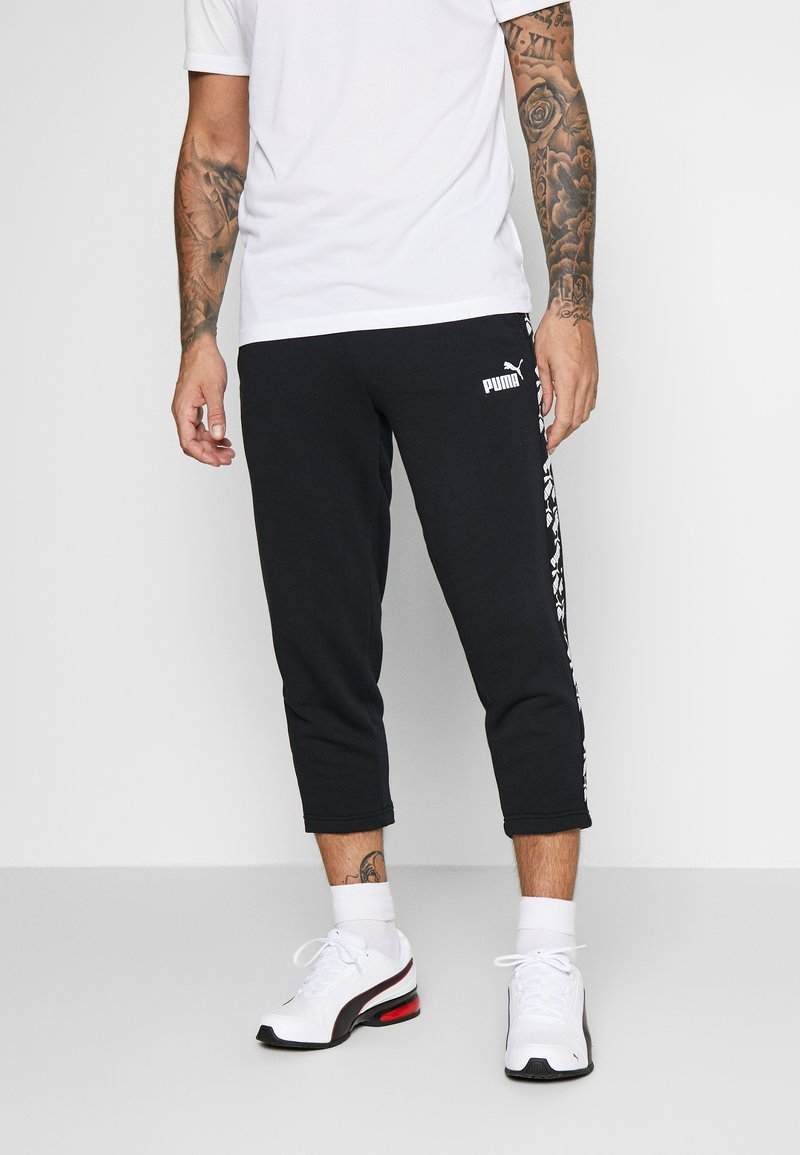 Puma - AMPLIFIED PANTS - Tracksuit bottoms - black