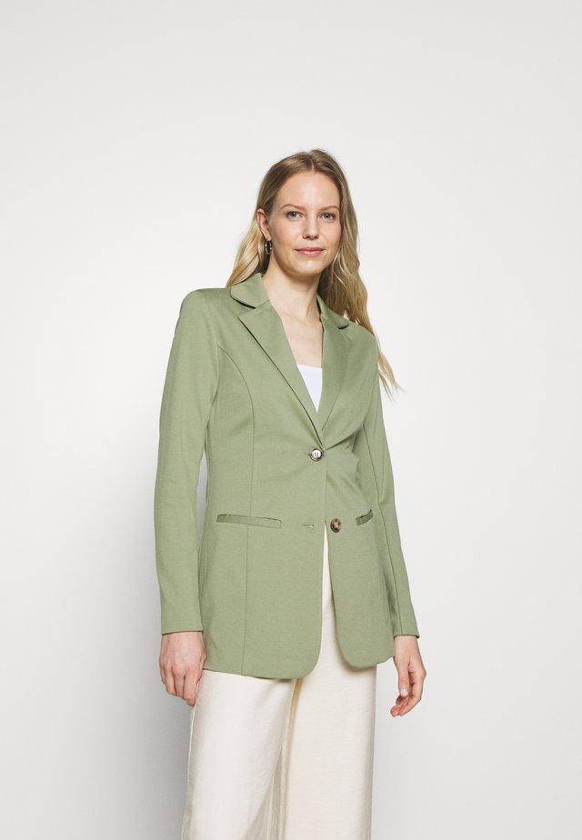 ANETT - Short coat - oil green