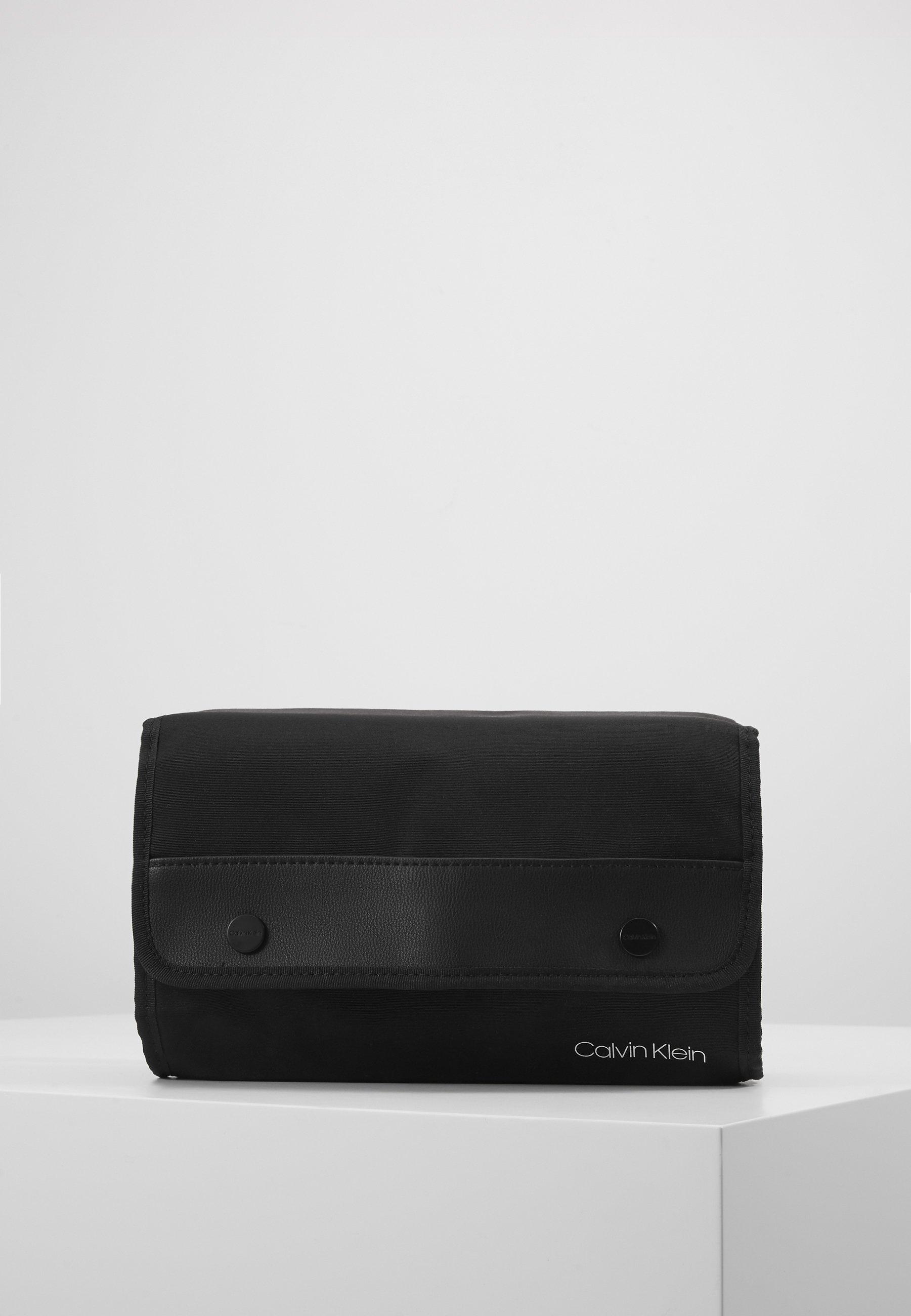 Rabatt Calvin Klein UNITED TRAVEL WASHBAG - Kosmetiktasche - black | Damenbekleidung 2020