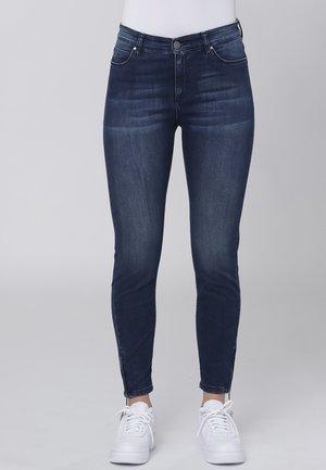 Slim fit jeans - dark blue w. use