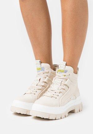 VEGAN ASPHA MID - Platform ankle boots - beige