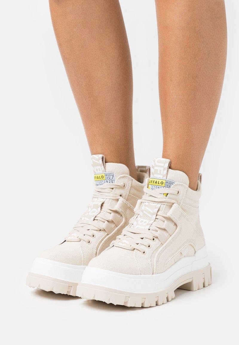 Buffalo - VEGAN ASPHA MID - Platform ankle boots - beige