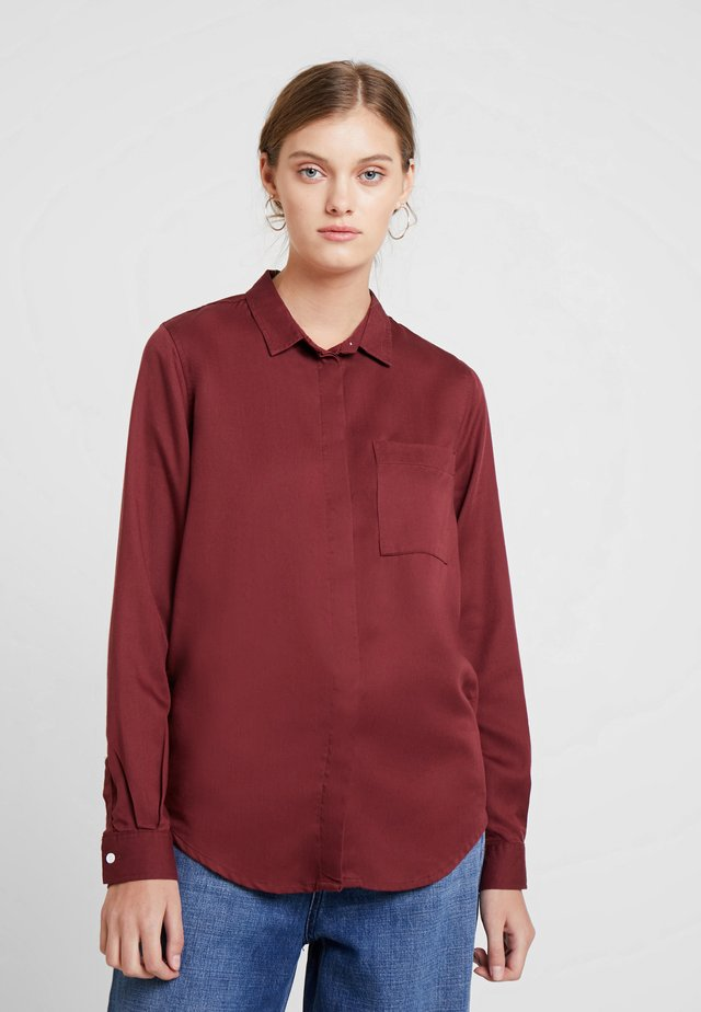 TAJA - Button-down blouse - rust