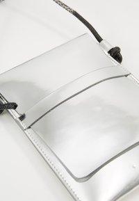 PB 0110 - Across body bag - silver - 2