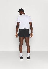 adidas Performance - FAST SPLIT - Sports shorts - black - 2