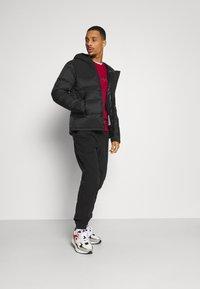 Champion - LEGACY HOODED JACKET - Training jacket - black - 1