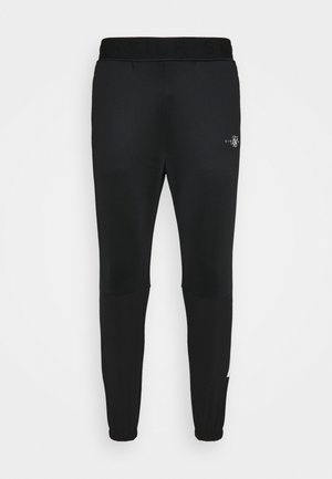 TRANQUIL TRAINING PANT - Spodnie treningowe - black/grey