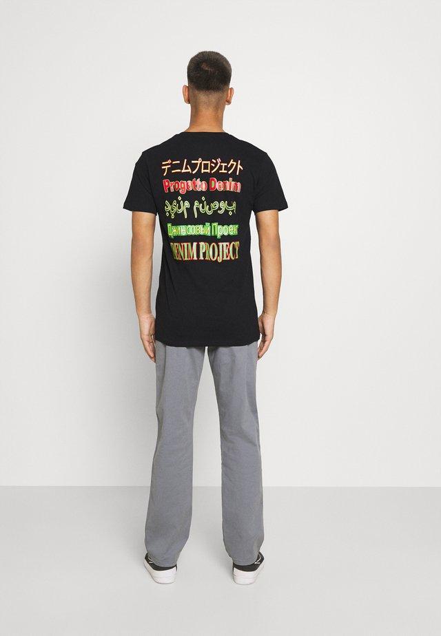MOJO TEE - Print T-shirt - black
