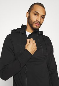 The North Face - STEEP TECH LOGO HOODIE UNISEX  - Hoodie - black - 3