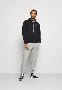 Nike Sportswear - MODERN - Sweatshirt - black/dark smoke grey/ice silver/white - 1