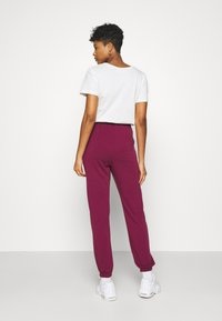 Missguided - BASIC - Tracksuit bottoms - burgundy - 2