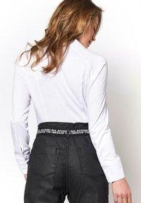 DESOTO - Button-down blouse - white uni - 1