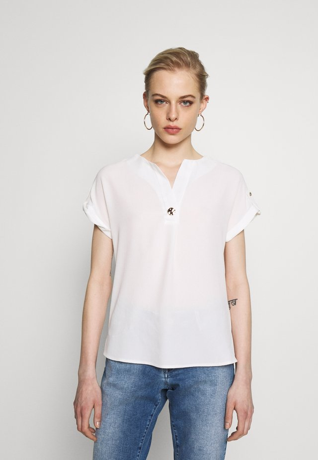 SUSTAINABLE UTILITY DROP SHOULDER - Blouse - ivory