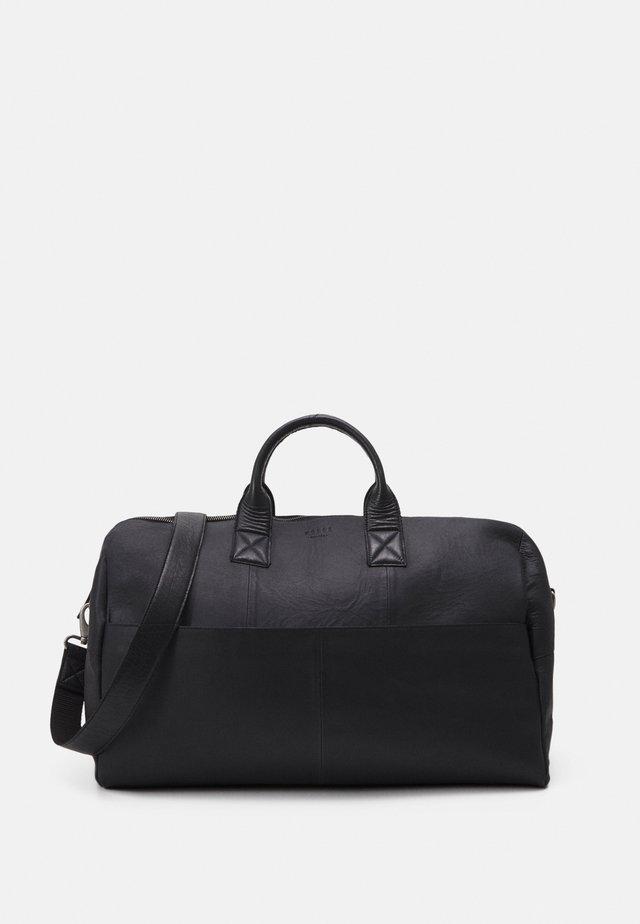 STORM - Weekend bag - black