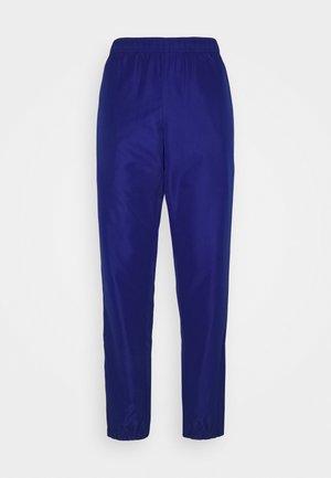 TRACKSUIT BOTTOMS - Spodnie treningowe - blue