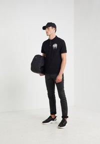 Just Cavalli - Polo shirt - black - 1