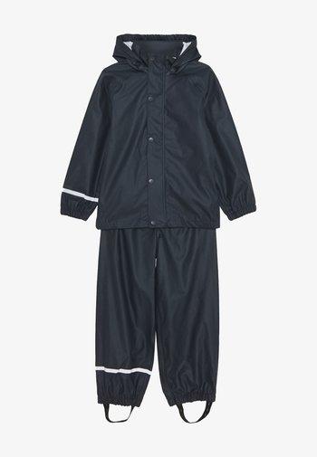 NKNDRY RAIN SET UNISEX - Kalhoty do deště - dark sapphire
