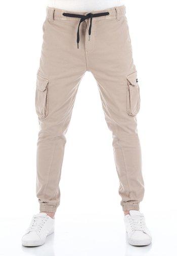 RIVHANNO - Cargo trousers - dark beige