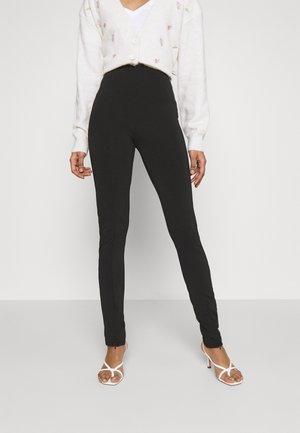 JADA SLIT - Leggingsit - black