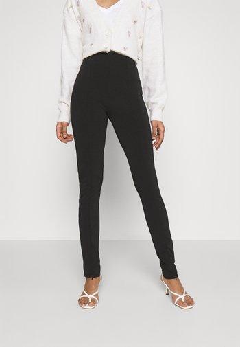 JADA SLIT - Leggings - Trousers - black