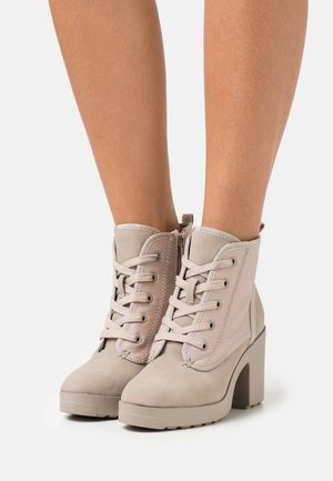 MOLLYY - Lace-up ankle boots - bone