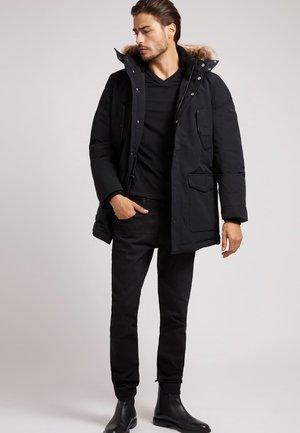 STEPP MIT KAPUZE - Down coat - schwarz