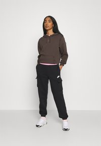 Nike Sportswear - PANT - Trainingsbroek - black/black/white - 1