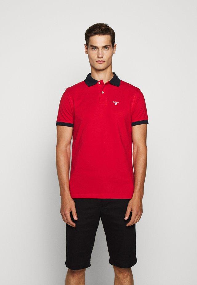 LYNTON - Polo shirt - salsa
