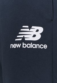 New Balance - Tracksuit bottoms - eclipse - 2