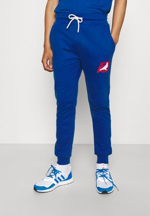 STACKED LOGO - Tracksuit bottoms - royal
