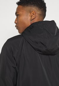 Champion Reverse Weave - HOODED JACKET - Větrovka - black - 3