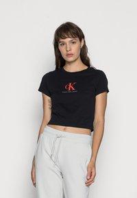 Calvin Klein Jeans - BABY TEE - Print T-shirt - black - 0