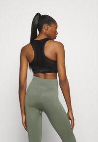 NU-IN - SPORTS BRA - Light support sports bra - black - 2