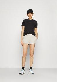 Calvin Klein Jeans - LOGO TRIM - Tracksuit bottoms - white sand - 1