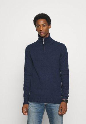 Stickad tröja - petrol blue