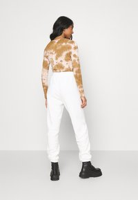 Topshop - TOWELLING - Tracksuit bottoms - white - 2