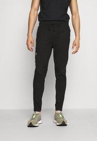 SQUATWOLF - LIMITLESS JOGGERS - Pantalon de survêtement - black - 0