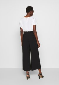 Filippa K - NAIA TROUSER - Trousers - black - 2